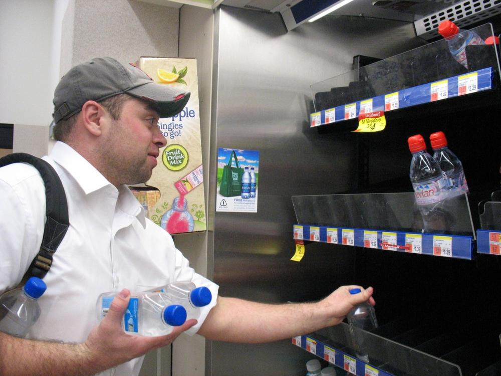 Mike Sullivan was lucky to get the last few bottles of water at a Boston drug store. (Monica Brady-Myerov/WBUR)