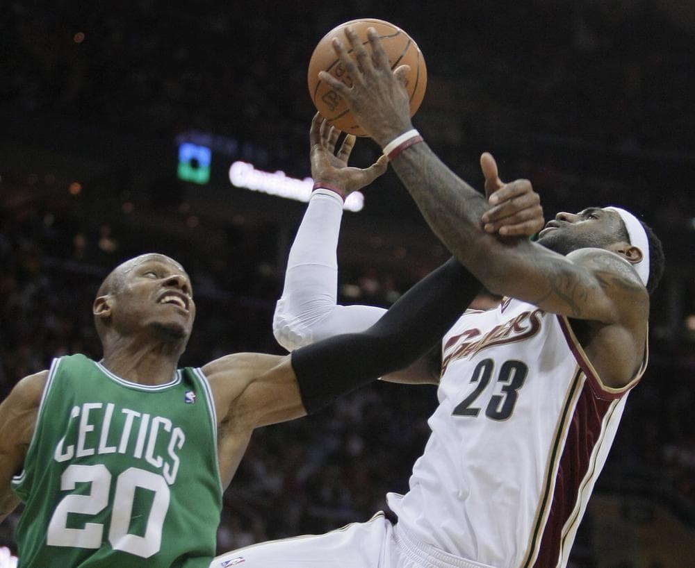 Celtics' Ray Allen (20) fouls Cleveland Cavaliers' LeBron James (23) in the third quarter. (AP Photo/Tony Dejak)