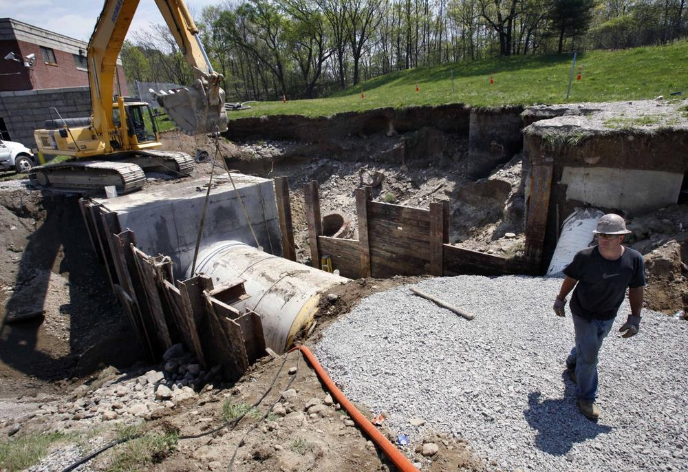 Repairs progressed Sunday in Weston, Mass. on a water main that failed on Saturday, sending millions of gallons of water into the Charles River and prompting Gov. Deval Patrick to issue an order for area residents to boil their tap water. (AP)