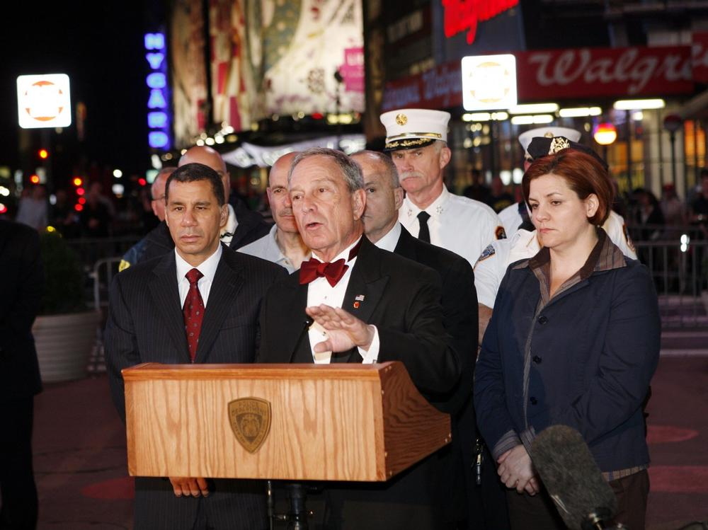 Mayor Michael Bloomberg, center, Governor David Paterson, left, and Speaker Christine C. Quinn, right hold a news conference in Times Square early Sunday morning,  near where a car carrying three propane tanks, fireworks and two filled 5-gallon gasoline containers was found Saturday night.  (AP Photo/David Karp)