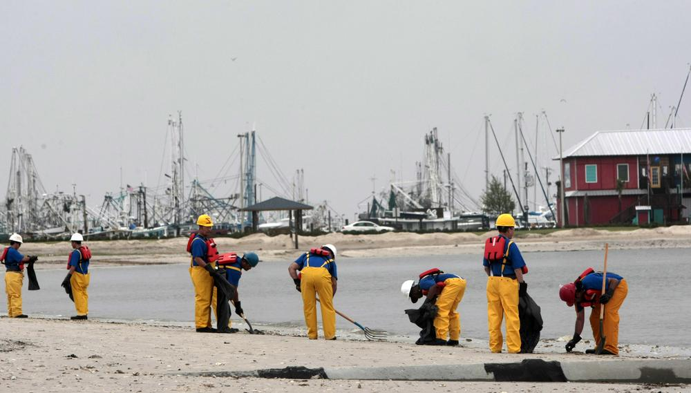 Crews working along the beach look for debris including dead sea life that has washed ashore in Pass Christian, Miss., Monday, May 3, 2010. (AP)