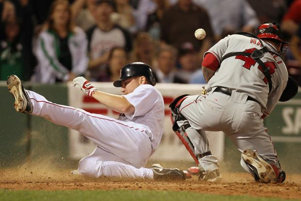 Boston's J.D. Drew slides safely into home as Los Angeles catcher Mike Napoli can't handle the throw during the sixth inning of the game in Boston on Monday. (AP)