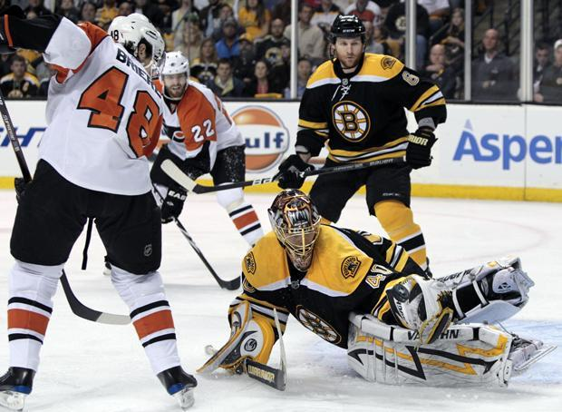 Boston goalie Tuukka Rask makes a pad save as Philadelphia center Danny Briere looks for a rebound during the first period of Game 2 of a second-round playoff series in Boston on Monday. (AP)