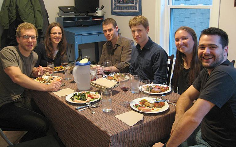 "A recent ""Paleo Potluck"" at the Somerville apartment of Michal Naisteter and Nate Rosenberg. (Andrea Shea/WBUR)"