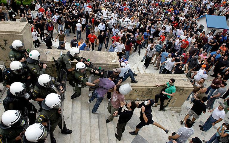 Protesters clash with riot police at the Greek Parliament in Athens on Wednesday. (AP)