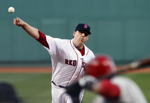Boston's John Lackey pitches against Los Angeles in the first inning of the game on Wednesday in Boston. (AP)