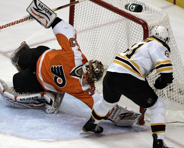 Philadelphia goalie Brian Boucher can't stop the shot by Boston's Miroslav Satan fom going in the net in the first period of Game 3 of a second-round playoff hockey series on Wednesday in Philadelphia. (AP)