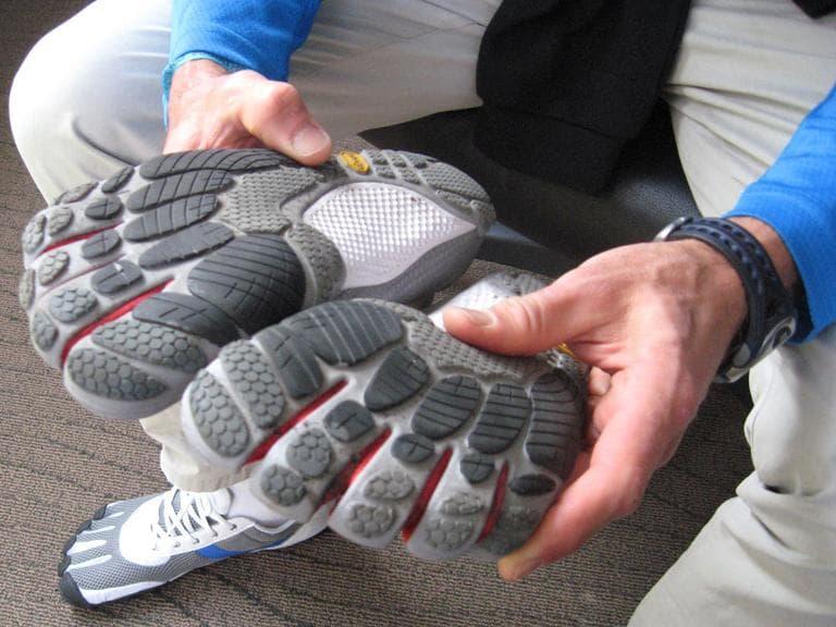 A runner displays the Vibram Five Fingers shoes. (Karen Given/WBUR)