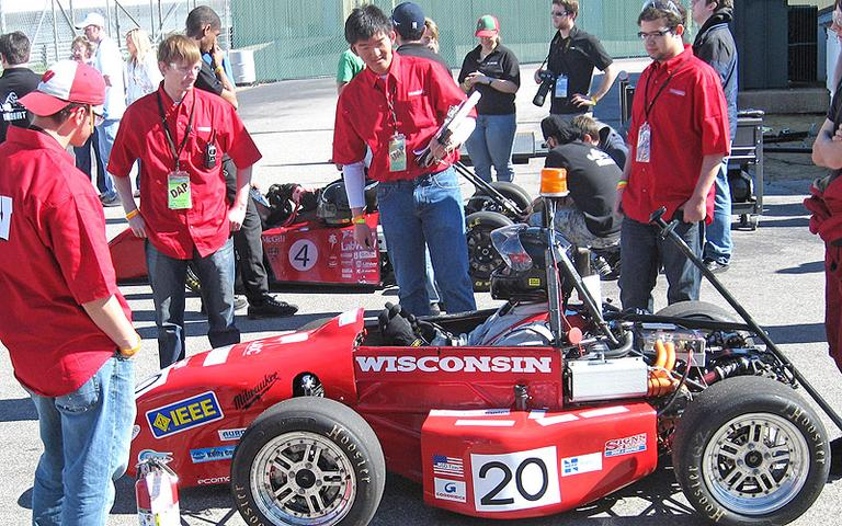 The University of Wisconsin team waits its turn during the morning's acceleration runs. (Doug Tribou/WBUR)
