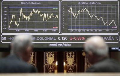 Traders look at a screen at Madrid's Stock Exchange. (AP)