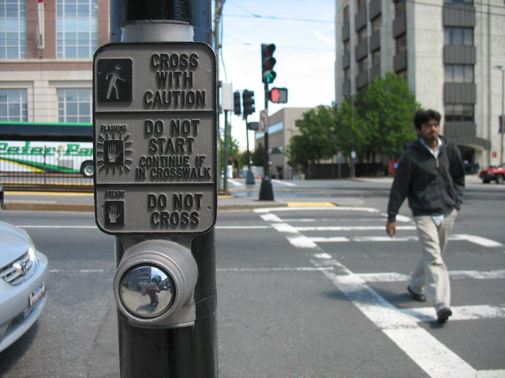 This button, at the corner of Commonwealth Avenue and St. Paul Street, triggers a walk sign 24 hours a day. A lot of buttons in Boston don't. (Adam Ragusea/WBUR)