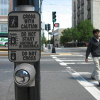 This crosswalk button, at the corner of Commonwealth Avenue and St. Paul Street, triggers a walk sign. A lot of buttons in Boston don't. (Adam Ragusea/WBUR)