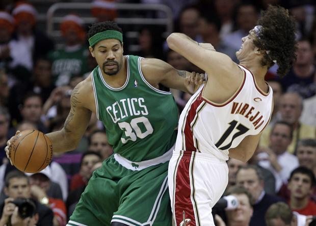 Boston's Rasheed Wallace commits an offensive foul against Cleveland's Anderson Varejao in the first quarter of Game 5 of a second round playoff series on Tuesday in Cleveland. (AP)