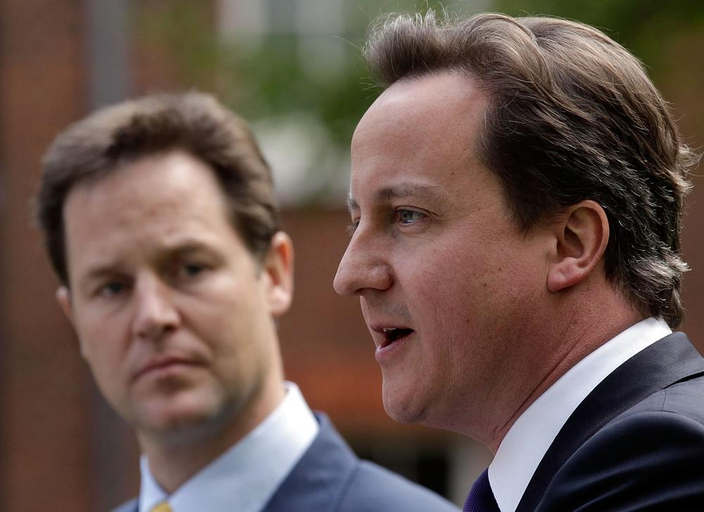 New British Prime Minister David Cameron, right, and Deputy Prime Minister Nick Clegg hold their first joint press conference in the garden of 10 Downing Street in London. (AP)