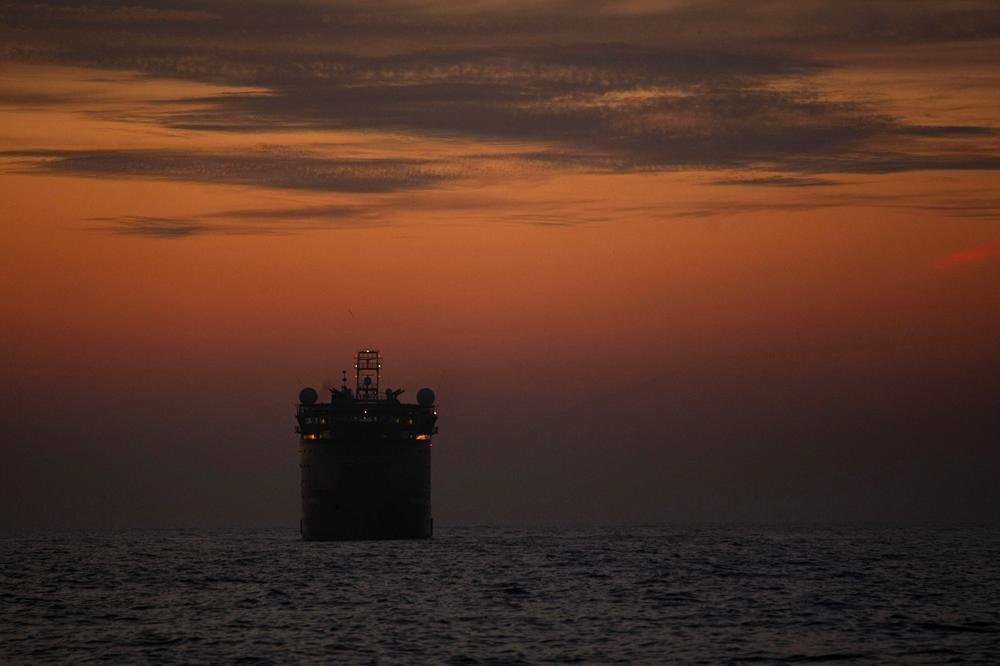 The Viking Poseidon, which is carrying the second containment device to be lowered to the sea floor, sits at sunset before deploying the device at the site of the Deepwater Horizon oil spill in the Gulf of Mexico.  (AP)