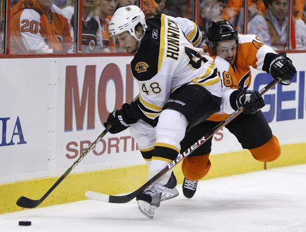 Boston's Matt Hunwick keeps the puck from Philadelphia's Danny Briere in the second period of Game 6 of a second-round playoff hockey series on Wednesday in Philadelphia. (AP)