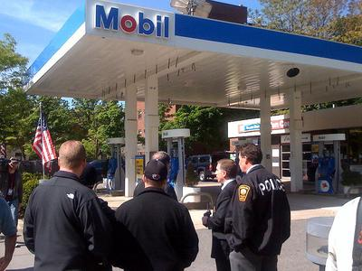 FBI agents search a Mobil station on Harvard Avenue in Brookline. (Adam Ragusea/WBUR)