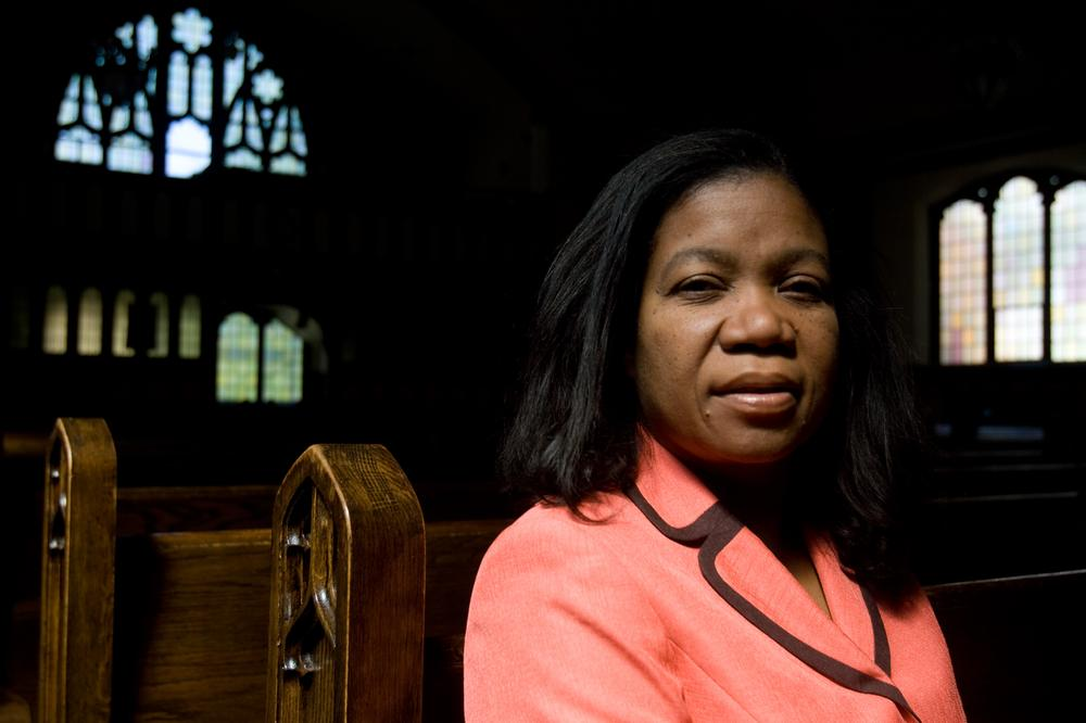 Jacqueline LaGuerre sits in the church where her husband is a pastor, Philadelphie Seventh Day Adventist Church, in Malden. (Jess Bidgood for WBUR)