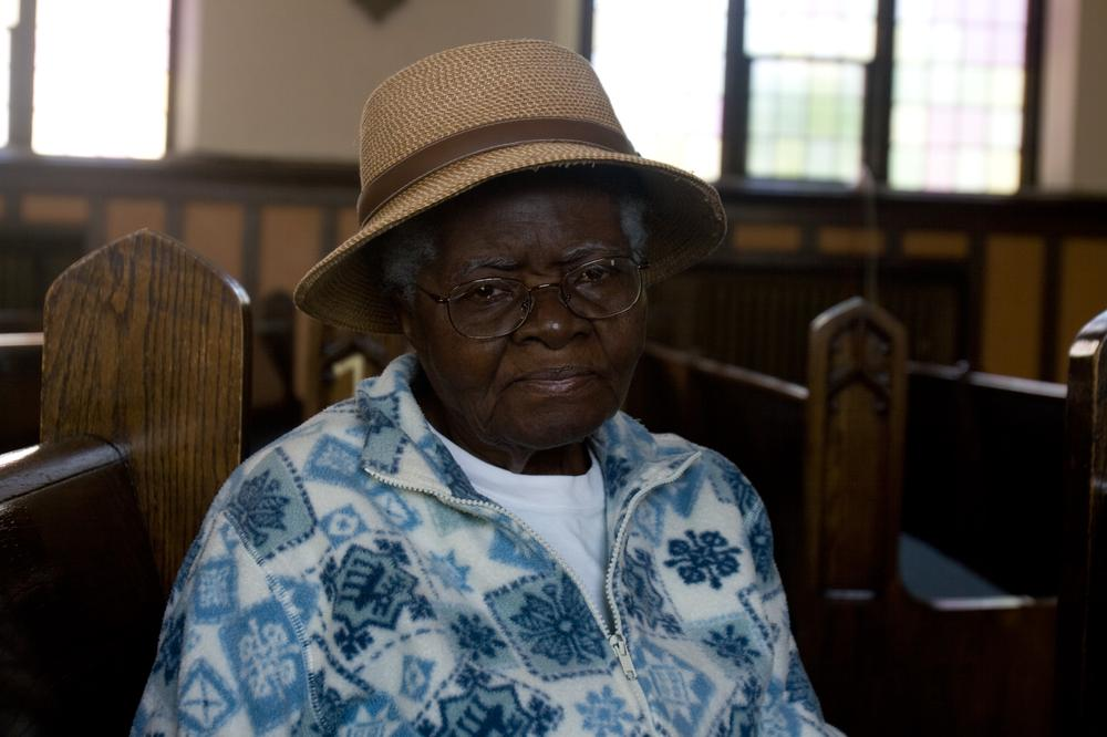 Sister Julie Noel Jean waits for church to begin at Philadelphie Seventh Day Adventist Church in Malden. (Jess Bidgood for WBUR)