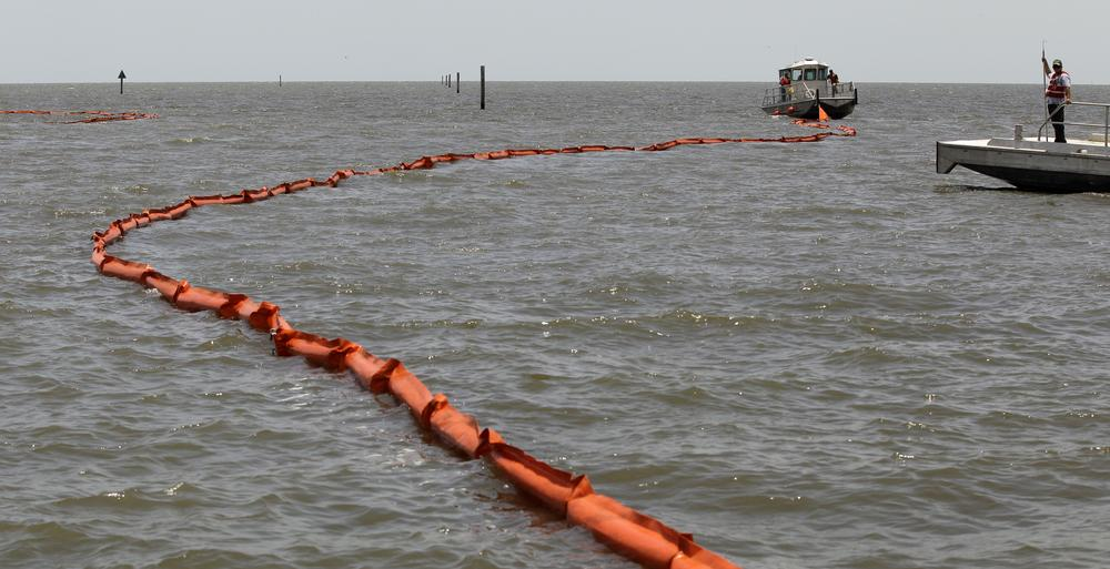 A boat pulls a boom into the Gulf of Mexico at Biloxi, Miss. Friday. The community was bracing for a possible land fall of an oil spill caused by the explosion of BP's Deepwater Horizon oil platform more than three weeks ago. (AP Photo/Charlie Riedel)