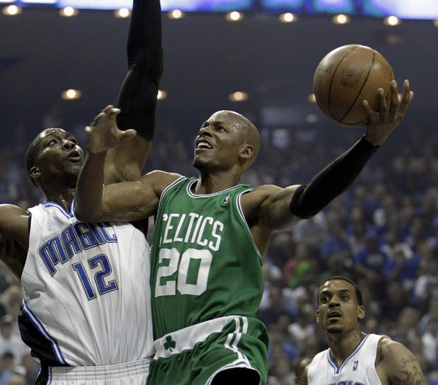 Boston guard Ray Allen takes a shot over Orlando center Dwight Howard during the first half in Game 1 of the NBA Eastern Conference finals in Orlando, Fla. on Sunday. (AP)