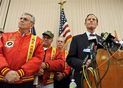 Connecticut Attorney General and Democratic candidate for U.S. Senate Richard Blumenthal, right, stands with veterans as he addresses a report that he has misstated his military service during the Vietnam War at a news conference in West Hartford, Conn. (AP)