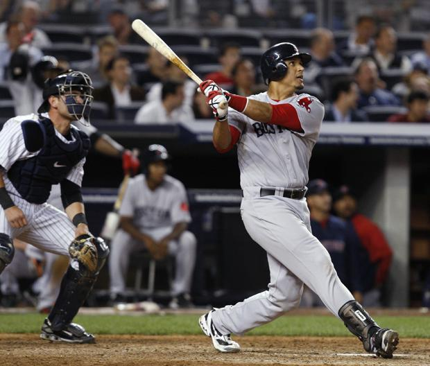 New York catcher Francisco Cervelli watches as Boston's Victor Martinez follows through on his eighth-inning solo home run in a game at Yankee Stadium in New York on Monday. (AP)