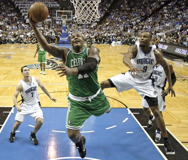 Boston forward Glen Davis drives in for a layup past Orlando forward Rashard Lewis and guard J.J. Redick during the second half in Game 2 of the NBA Eastern Conference finals in Orlando, Fla. on Tuesday. Boston won 95-92. (AP)