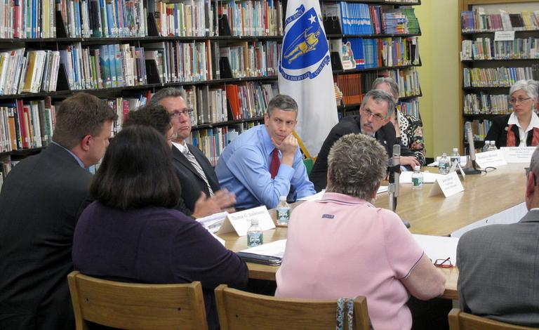 U.S. Education Secretary Arne Duncan (blue shirt) meets with state education officials at the Paul Revere School in Revere on Wednesday. (Deborah Becker/WBUR)