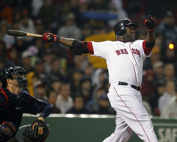 Boston's David Ortiz follows through on a two-run home run in front of Minnesota's Joe Mauer in the fourth inning of the game on Wednesday in Boston. (AP)