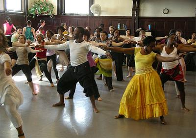 Jean Appolon, center, leads a recent Haitian dancing class in Cambridge's Central Square. (Chris Burrell for WBUR)