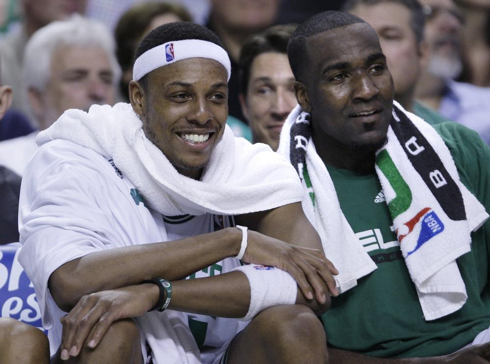 Paul Pierce smiles as he watches the end of the fourth quarter with teammate Kendrick Perkins. .(AP Photo/Charles Krupa)