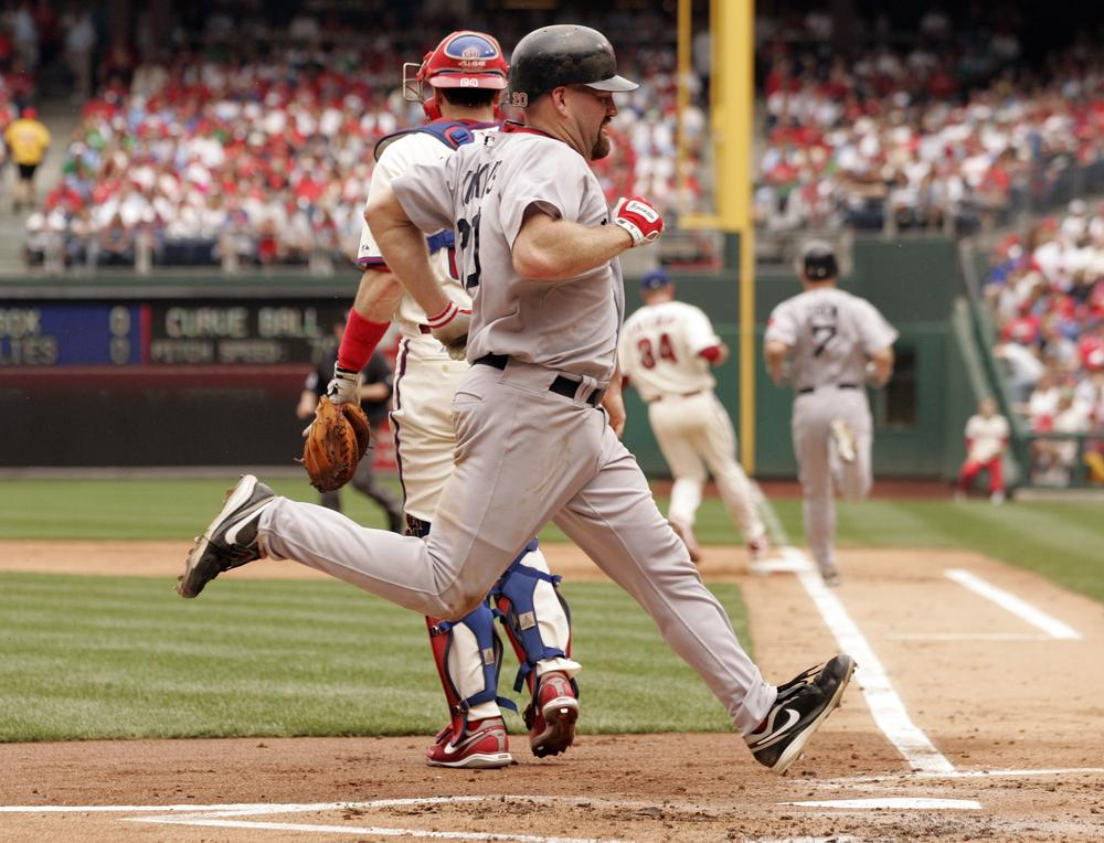 Boston's Kevin Youkilis scores on a ground out by J.D. Drew during the second inning of in an interleague baseball game with Philadelphia on Sunday in Philadelphia. (AP)