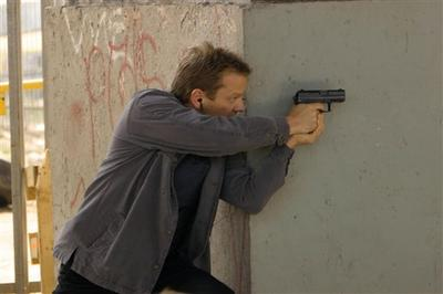 "Kiefer Sutherland as agent Jack Bauer draws his gun in a scene from Fox's ""24,"" in this undated publicity photo. (AP)"