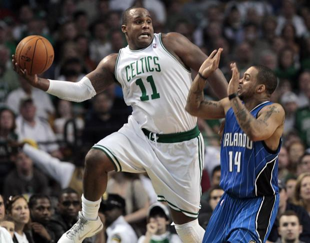 Boston forward Glen Davis saves the ball from going out of bounds as Orlando guard Jameer Nelson reacts during the first half of Game 3 of the NBA Eastern Conference finals in Boston on Saturday. (AP)