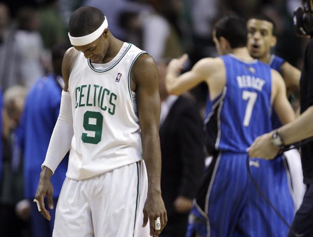 Boston guard Rajon Rondo walks off the court as Orlando guard J.J. Redick and teammates celebrate a 96-92 overtime win in Game 4 in the NBA Eastern Conference finals in Boston on Monday. (AP)