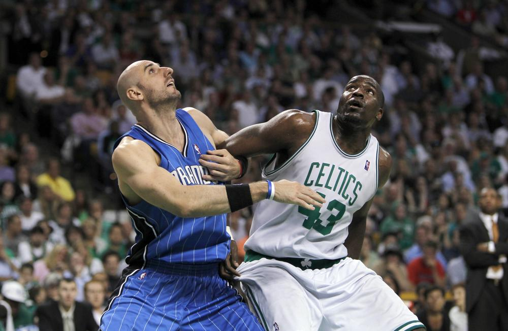 Orlando Magic center Marcin Gortat, left, and Boston Celtics center Kendrick Perkins, right, battle for rebound position during Monday's Game 4 in the NBA Eastern Conference finals in Boston.(AP)