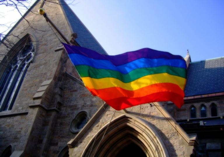A pride flag hanging in front of Boston's First Baptist Church in support of gay marriage and civil rights. B Tal/Flickr