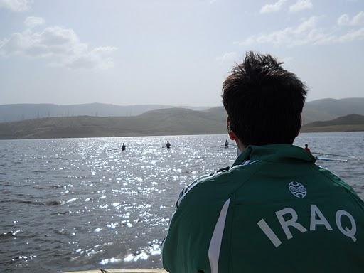 A member of the Iraqi rowing team looks out at Lake Dokan. (Courtesy of Bruce Smith/Community Rowing)