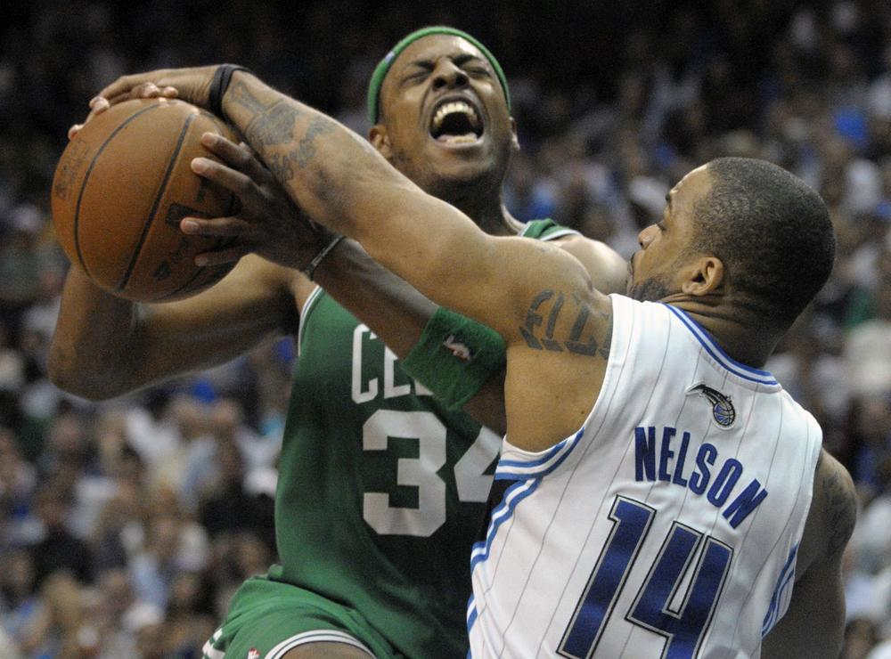 Orlando guard Jameer Nelson strips the ball from Boston forward Paul Pierce while going up for a shot during the second half in Game 5 of the NBA Eastern Conference finals in Orlando, Fla. on Wednesday. The Magic won 113-92. (AP)