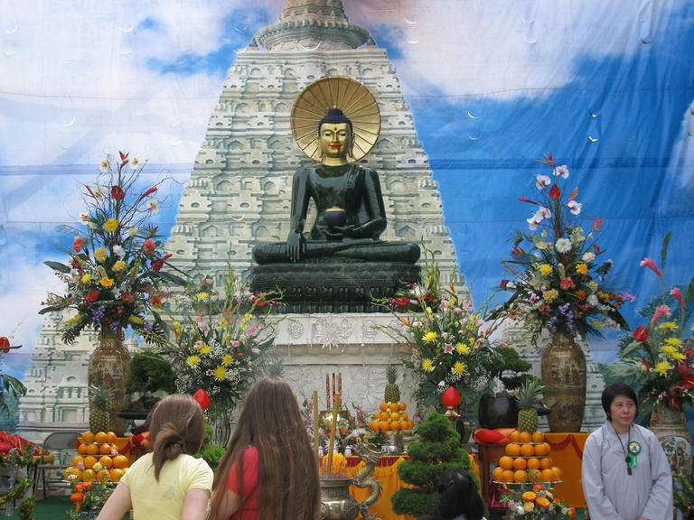 The statue of Buddha, a spiritual teacher from ancient India who founded Buddhism, is made of jade. It weighs four tons and is valued at about $5 million. (Deborah Becker/WBUR)