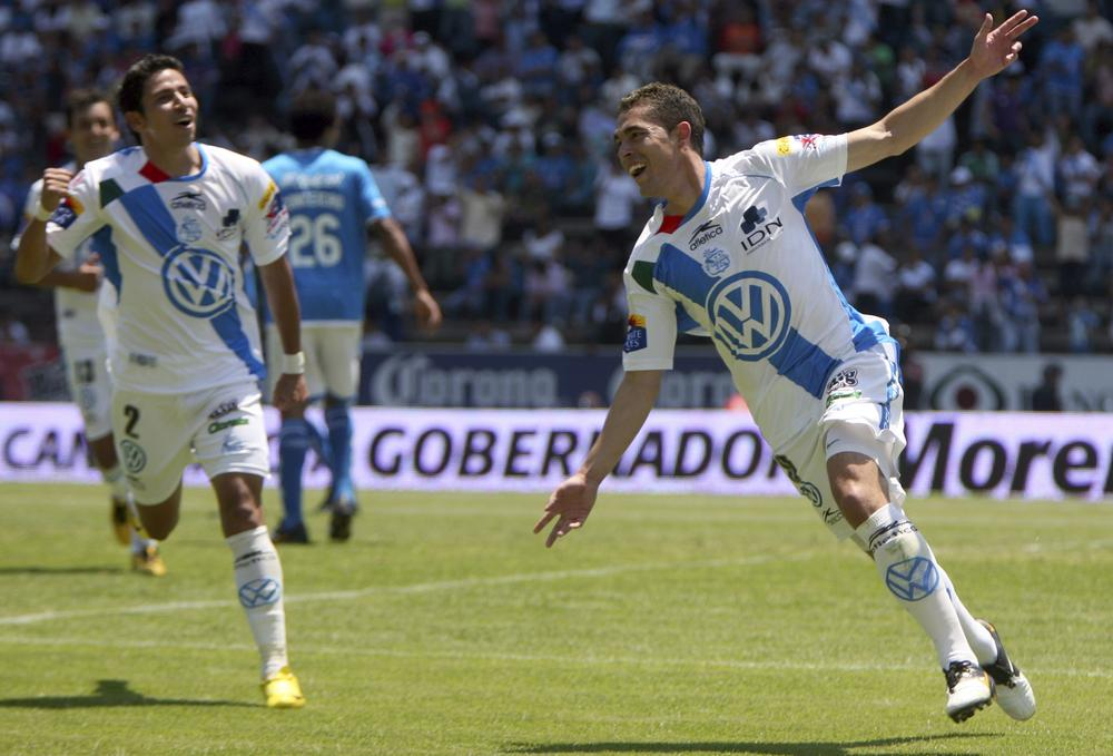 Herculez Gomez, right, celebrates his goal during a Mexican soccer league match against Cruz Azul in Puebla, Mexico, in April. (AP)