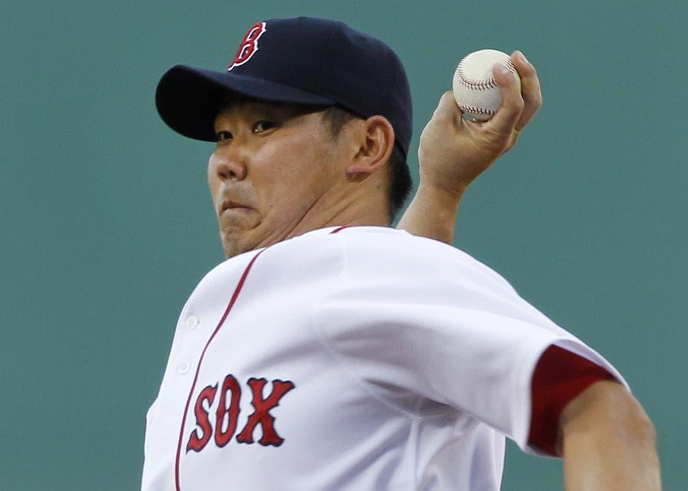 Boston starter Daisuke Matsuzaka delivers against Kansas City during the first inning of the game in Boston on Thursday. (AP)