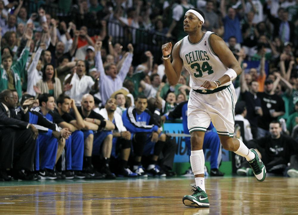Paul Pierce celebrates a three-point basket as he runs past the Orlando Magic bench during the fourth quarter in Game 6 of the NBA Eastern Conference basketball finals. (AP Photo/Charles Krupa)
