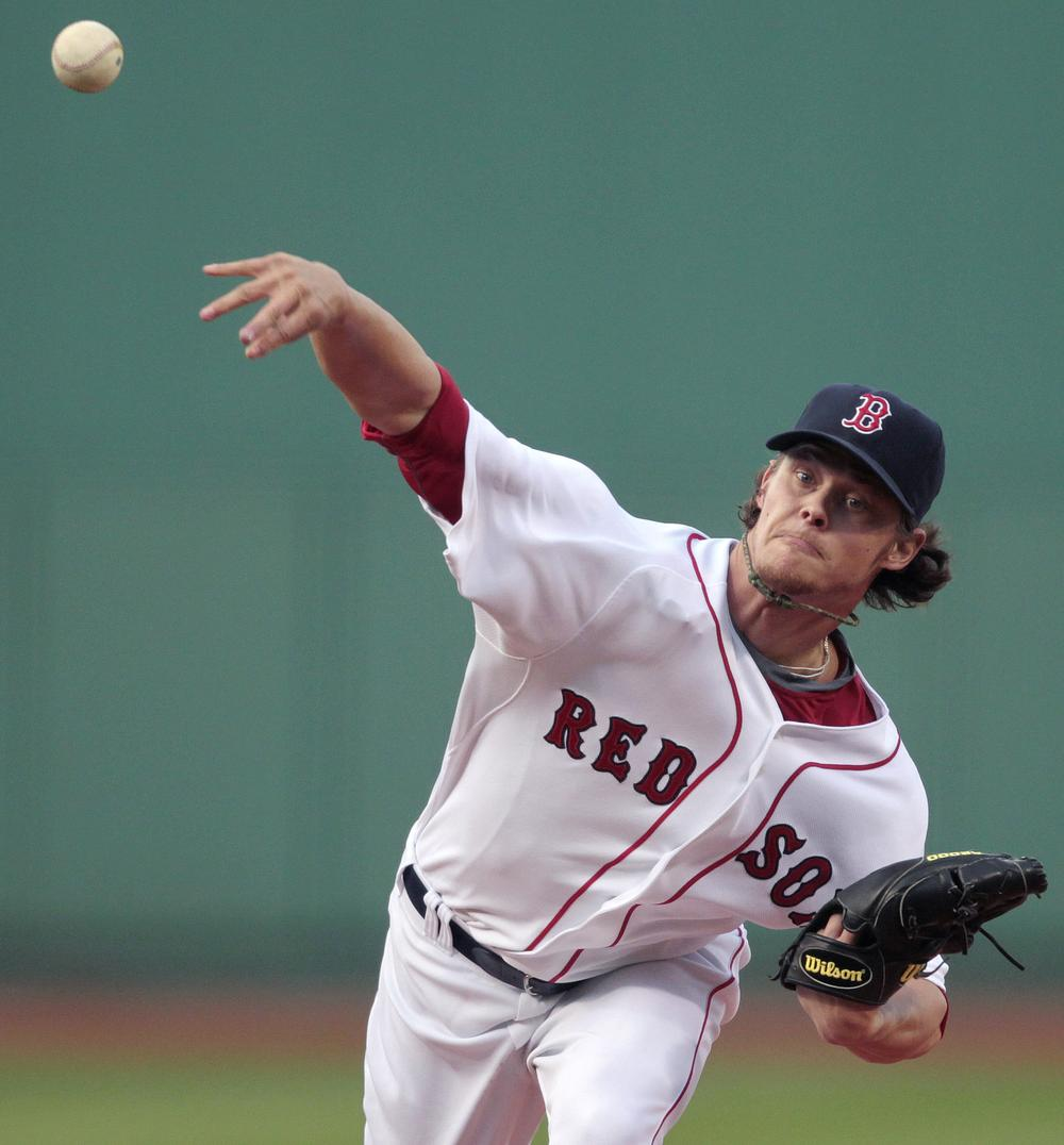 Clay Buchholz pitches in the first inning of a baseball game against the Kansas City Royals, Saturday. (AP Photo/Michael Dwyer)