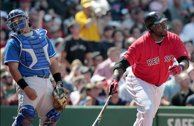 Kansas City's Brayan Pena looks away as Boston's David Ortiz watches his two-run home run in the fifth inning of the game on Sunday in Boston. (AP)
