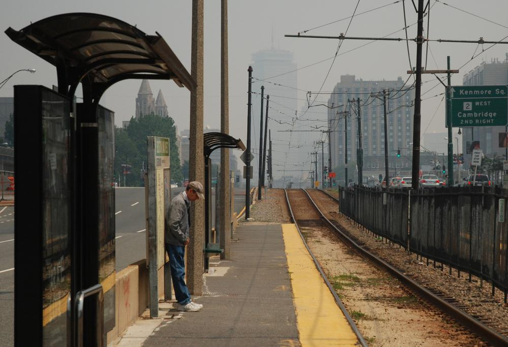 Smoky haze has cut visibility in Boston. Here, the Boston skyline is barely discernable behind the Boston University West MBTA stop on Commonwealth Avenue. (Jess Bidgood for WBUR)