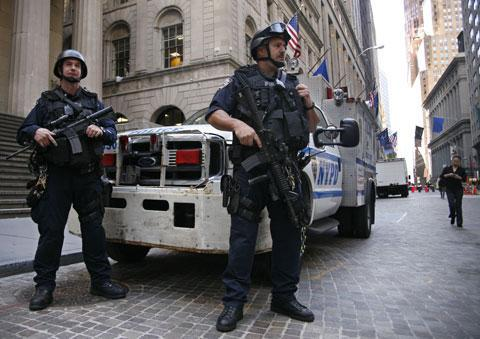 The New York Police Department's Emergency Service Unit patrols the financial district in New York on Friday, May 7, 2010. (AP)