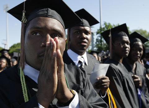 Ryan Brown of Deptford, N.J., and other seniors wait in anticipation for President Barack Obama to address the graduates of Hampton University, Sunday, May 9, 2010. (AP)