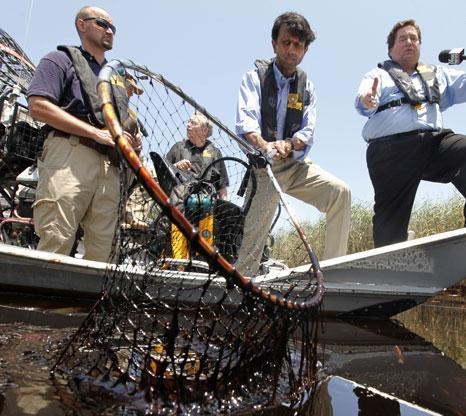 Louisiana Gov. Bobby Jindal, center, tours the oil impacted marsh of Pass a Loutre, La. on Wednesday, May 19, 2010. Oil from the Deepwater Horizon oil spill is infiltrating the coast of Louisiana. (AP)